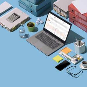 Financial report on a laptop screen, paperwork and office supplies on a desktop: business management and technology concept, blank copy space